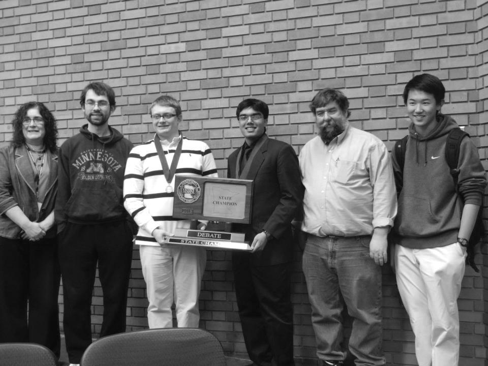 Blake debaters Kentucky Morrow '13, Hirsh Shekhar '14, and Allen Wang '16 pose with their coaches.