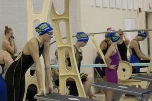 Zoe Nyberg-Powell '17 (left) looks out at the pool as she gets ready to race her 200 IM.