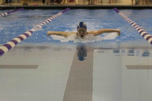 Caitlin McCandler '15 powers through her 100 butterfly.