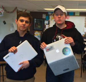 "Jimmy Gruver '17 and Reece Sanders '17 prepare to say ""good-bye"" to their old laptops."