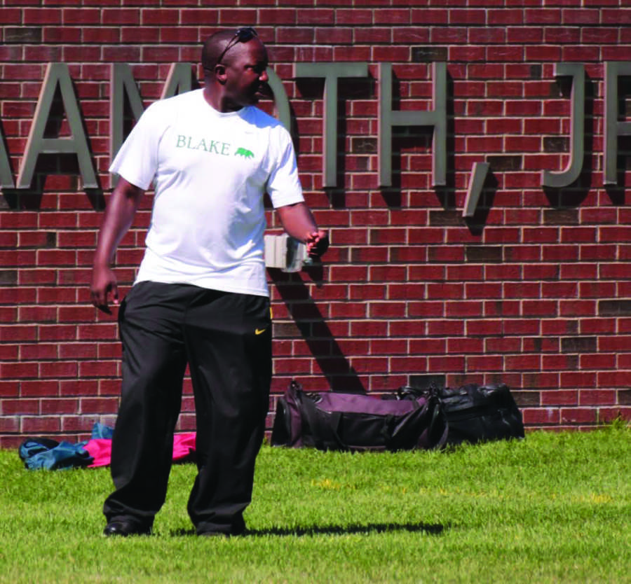 Coach Tamba John directs  his players from the sidelines of Aamoth Stadium.
