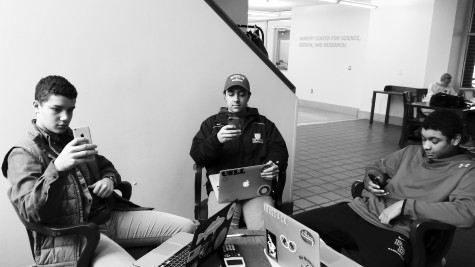 Cal Slavitt '16, Tyler Kossila '16 and Brandon Boyd '16 all take a study break on their phones.