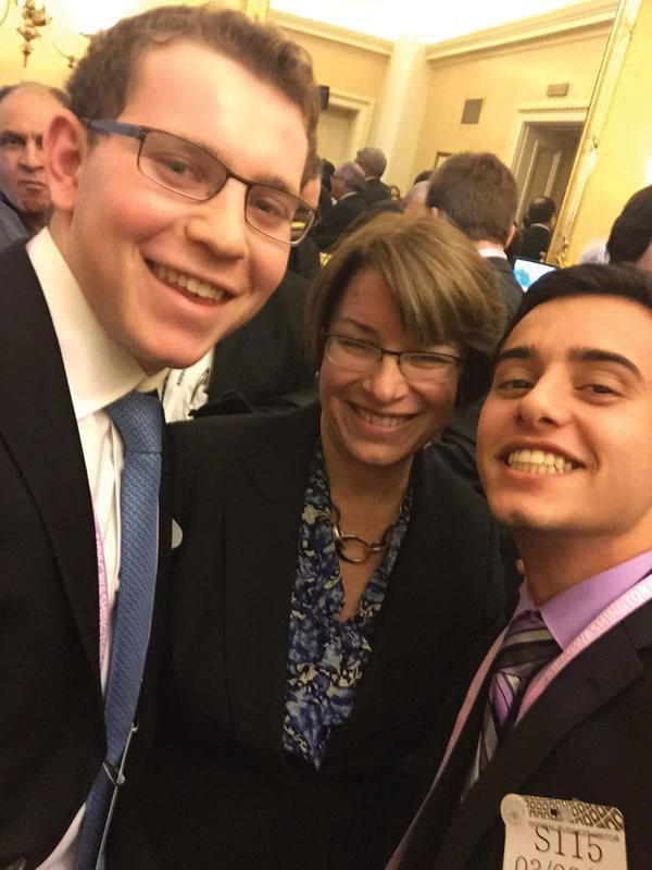 Gittleman and his friend AJ Yablonski take a picture with Minnesota Senator Amy Klobahar