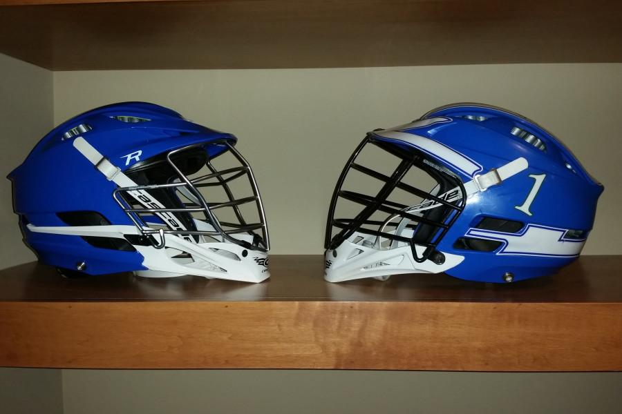 Two Blake lacrosse helmets. A new Cascade R helmet on the left and an old Cascade CPX-R helmet on the right.