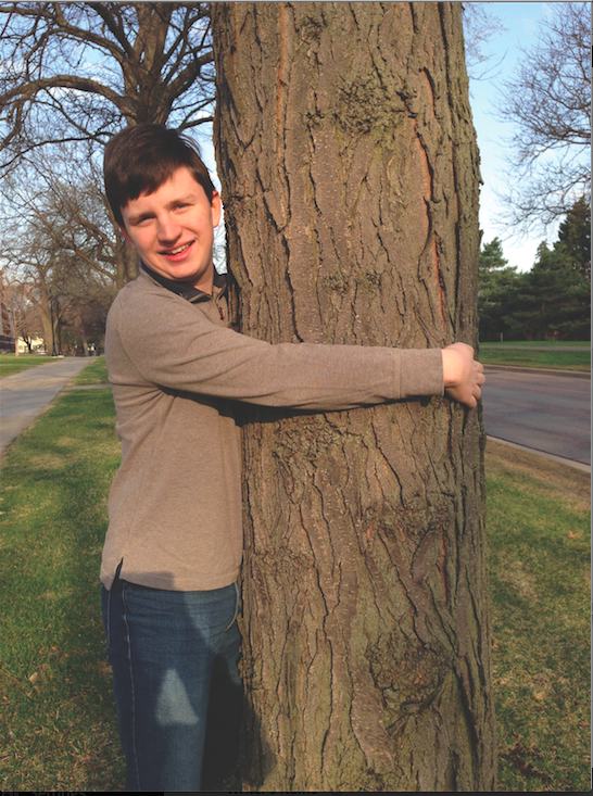 Brendan Barrow, devoted treehugger, on the school's front lawn