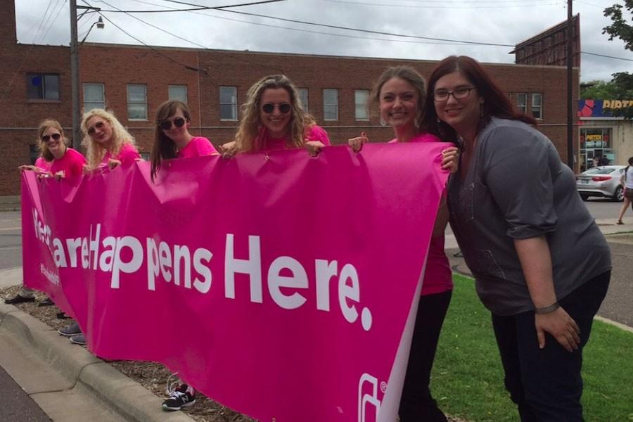 Maxine Whitely 16 along with her colleagues at Planned Parenthood holding up a banner at one of the protests against the organization.