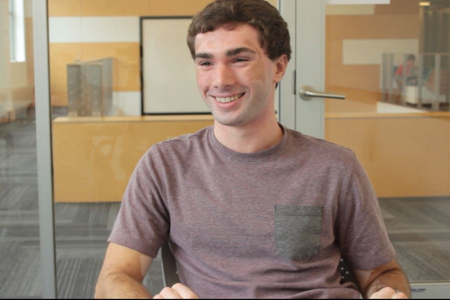 Ben Weinshel '15 smiles for a quick photo as he describes his internship at the tech department this summer.