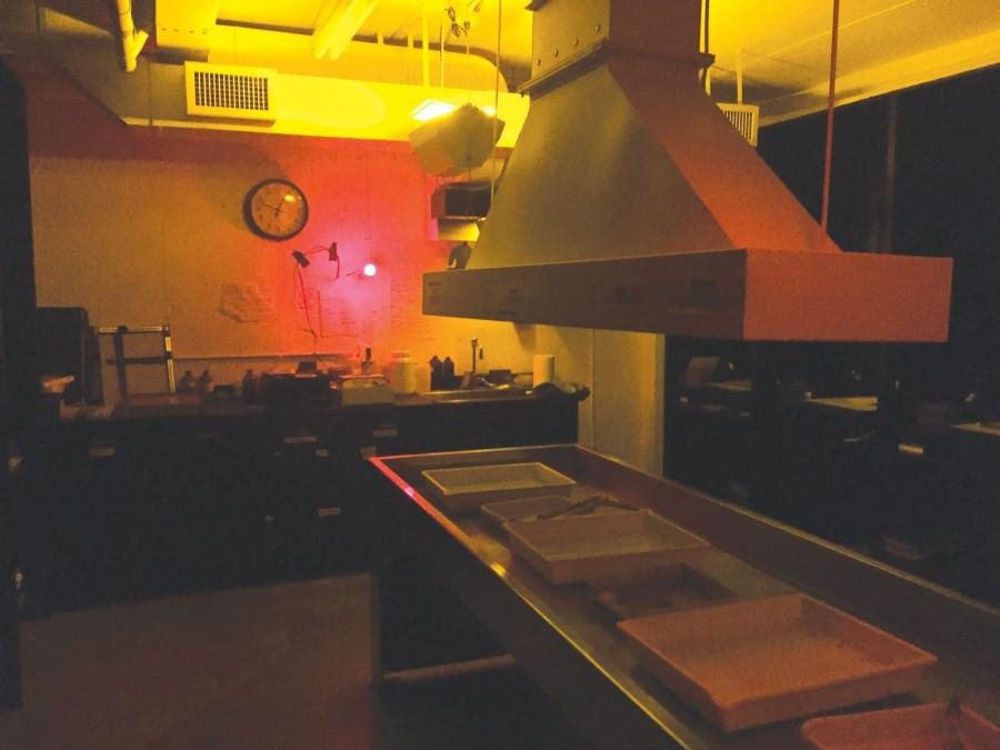 The school's darkroom, which in use is illuminated by a dim red light so that students can see what they are doing, but the film isn't overexposed.