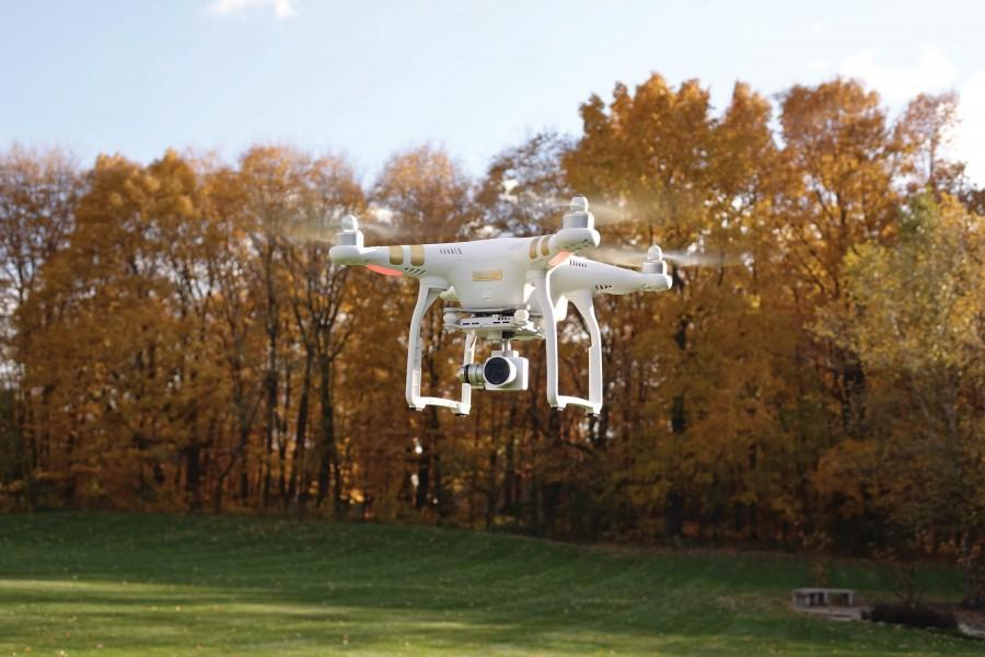 Recreational+quadcopters+can+be+retrofitted+to+hold+cameras+and+can+fly+up+to+a+mile+away+from+the+controller.