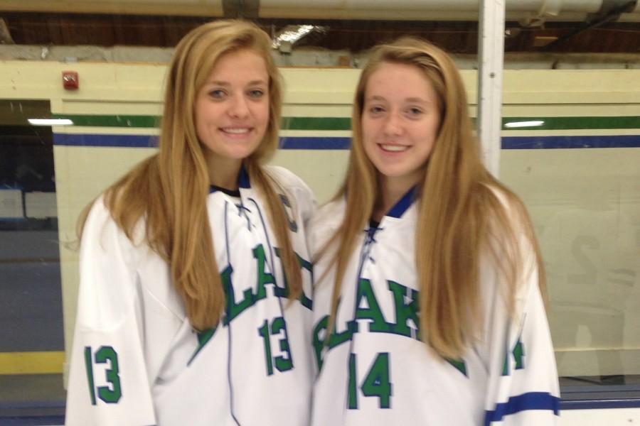 CC and Sylvie Wallin show off their hockey jerseys