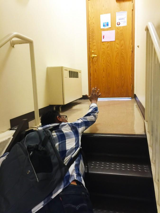 Josh Wilson '18 struggles to finish the climb from the math wing to the third floor.