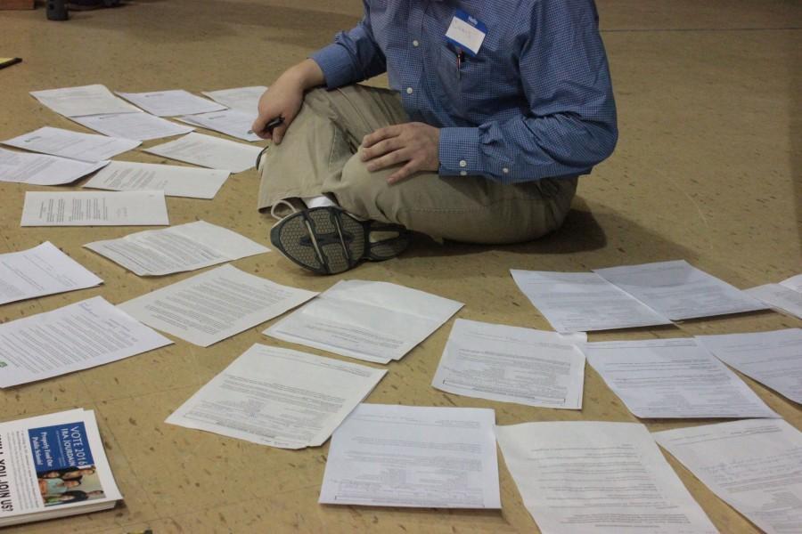 A community leader organizes resolutions at Lake Harriet Upper Community School.