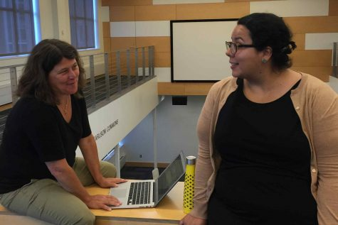 Karen Phillips and Ann Rubin discuss schedules in the library