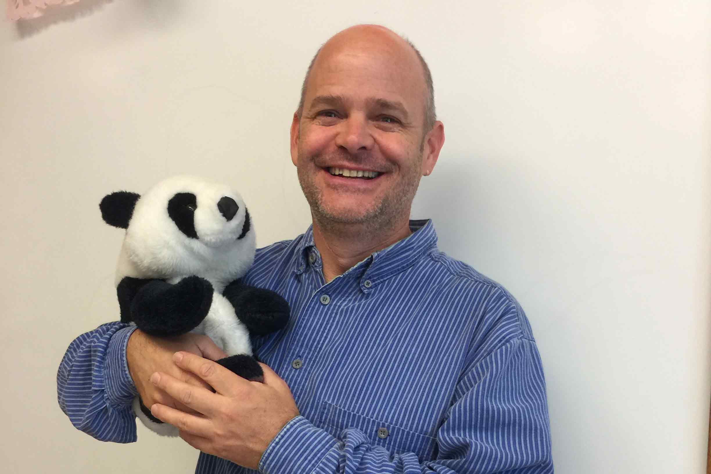 Jon Dicus holds Canvas, a panda bear used in class to show students how friendly the program can be.