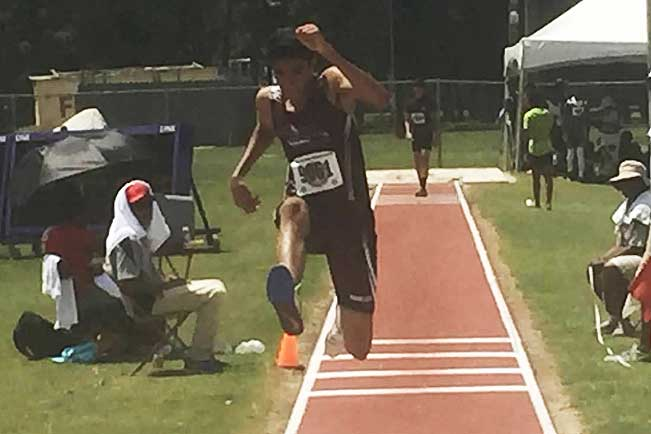 Shiv Jhanjee '18 competing in triple jump at Track Nationals in Houston.