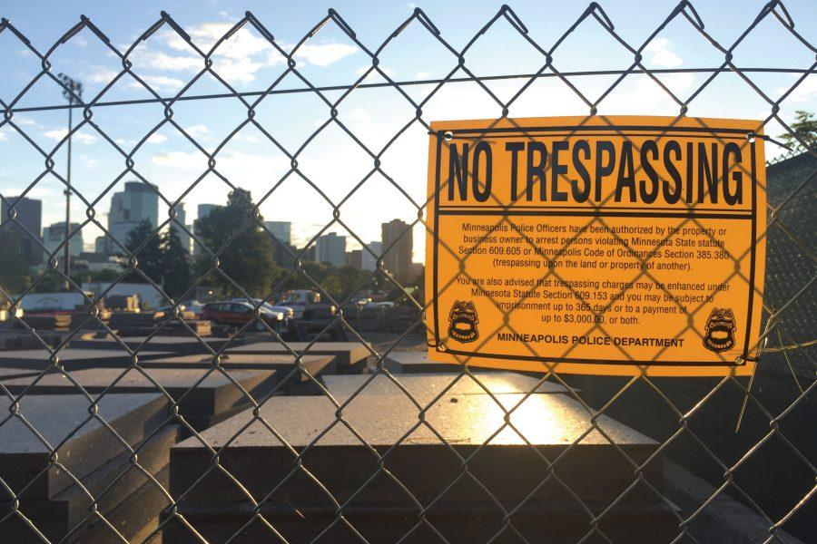 No Trespassing sign on the fence by the student parking lot Walker construction.