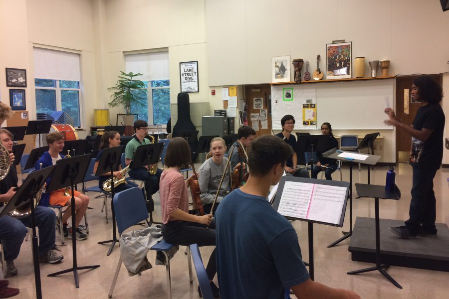Ursa Major in a practice session. Julien Ueda '17 conducts the group for the upcoming concert.