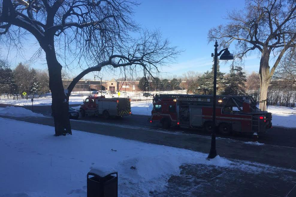 Fire trucks lined up outside the main entrance to the building after students and faculty funneled back into the building.