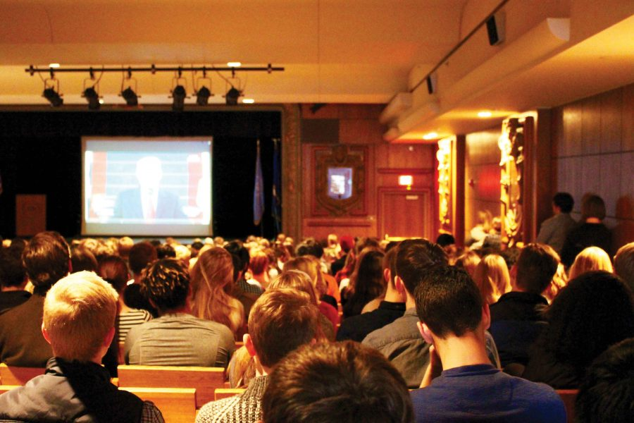 Students watch the inauguration of Donald Trump live in the Julliet Nelson Auditorium while some students chose to leave and accept the consequences. The students who peacefully protested left after the new president was sworn in.