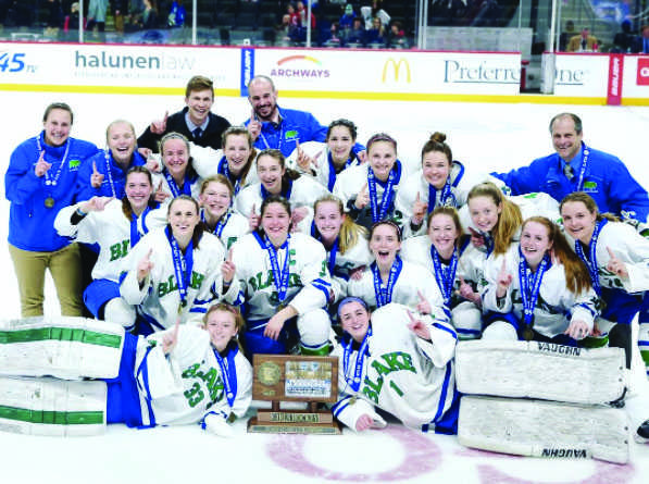 Girls' Hockey along with Coach Shawn Reid and assistant coaches Alex Ward, Cody Bishop, Maryanne Menafee, and Ashley Stenerson with their championship plaque state on February 25.
