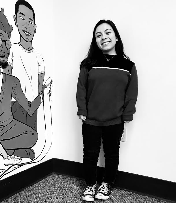 Eva Motolinia '18 poses near the 3rd floor mural.