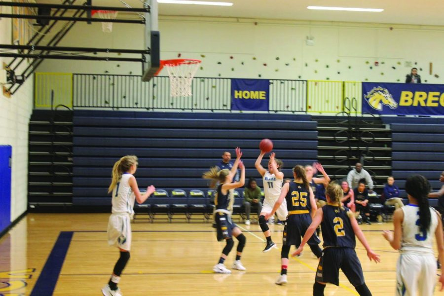 Sara Gregor '19 and Cate Moe '21 make a pass against Breck.