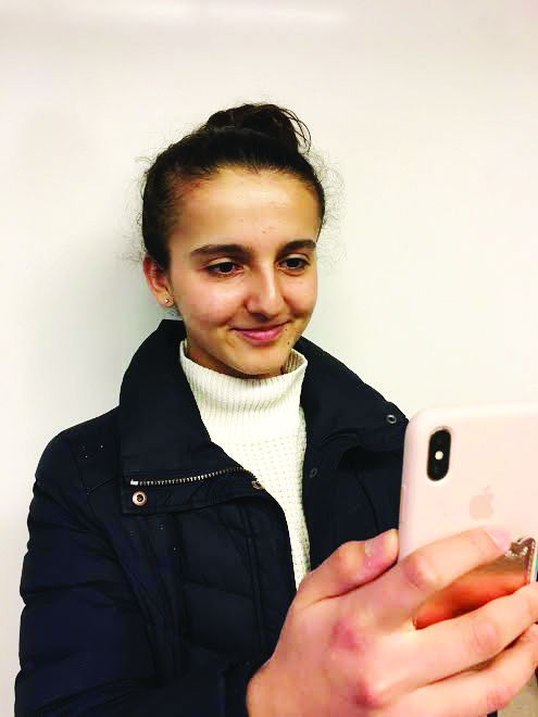 Sonia Baig '21 demonstrates the facial recognition technology on the iPhone X.