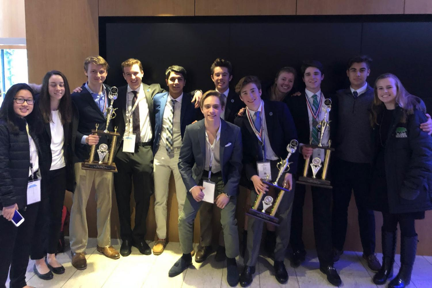 The Blake DECA team at the district competition after winning several awards.