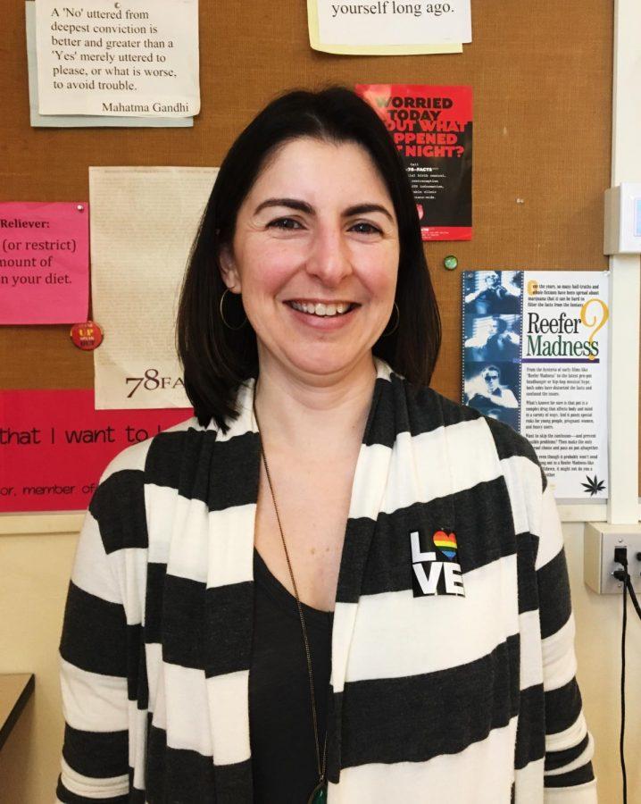 Cris Larson shows LGBTQ support with love sticker
