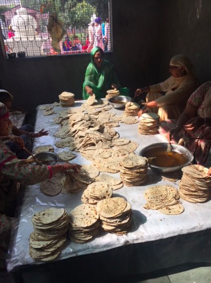 At the Golden Temple, students were able to walk through the kitchen where volunteers make food to feed upwards of 100,000 people every day, and they put no limit on how many people can eat there. This picture shows some of the volunteers making vast amounts of nan, a leavened, oven-baked flatbread which is very common in India. It was incredible for the group to see the huge pots volunteers were cooking with and all of the people who were sitting in the large spaces to eat.