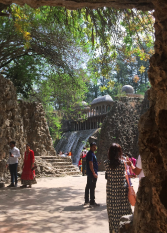 A gorgeous view of a waterfall in the rock garden of Chandigarh where their were amazing sculptures, decorated in all colors of stone. This was a popular spot for taking photos.