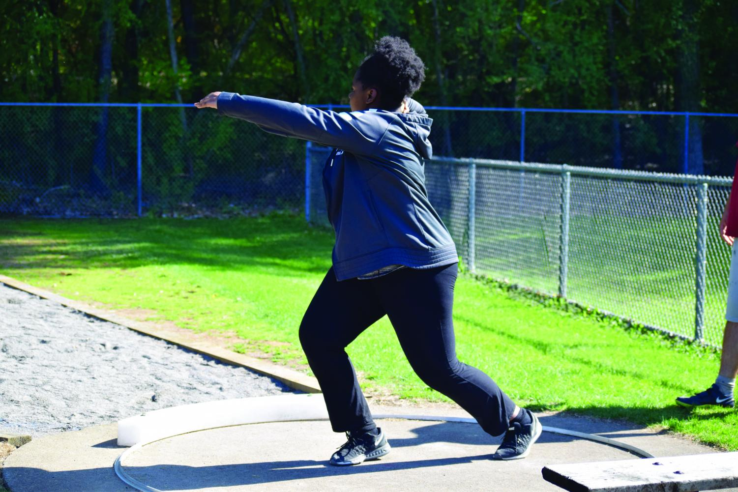 Cheryl Minde '20 throws a discus during a practice. The team practices all of their various events along the fields and track at the Hopkins campus.