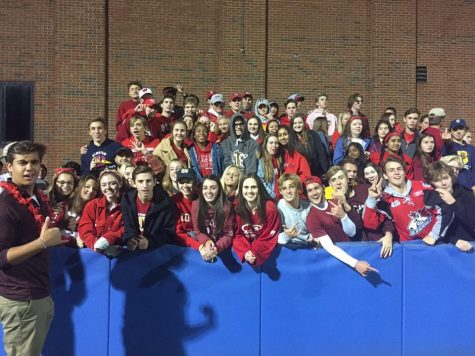 Students on bleachers of new student section theme red for Minnehaha High School homecoming game against Washburn on September 21.