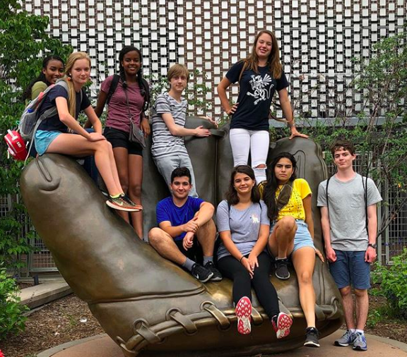 Shenelle Haines' advisory  visits a sculpture near Target Field, the home of the Minnesota Twins. The advisory that found the most things from the checklist (given out before the walk began) will receive a prize in the weeks following the annual Sophomore Walk.