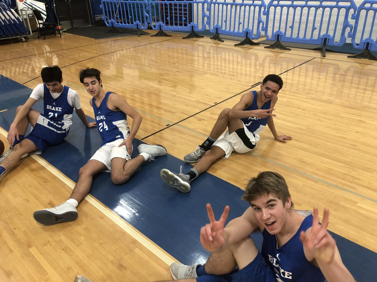 Sophomores Gabe Ganz '21, Robert Grace '21, and Jasper Liu '21 and junior Patch Fechtmeyer '20 warm up before practice