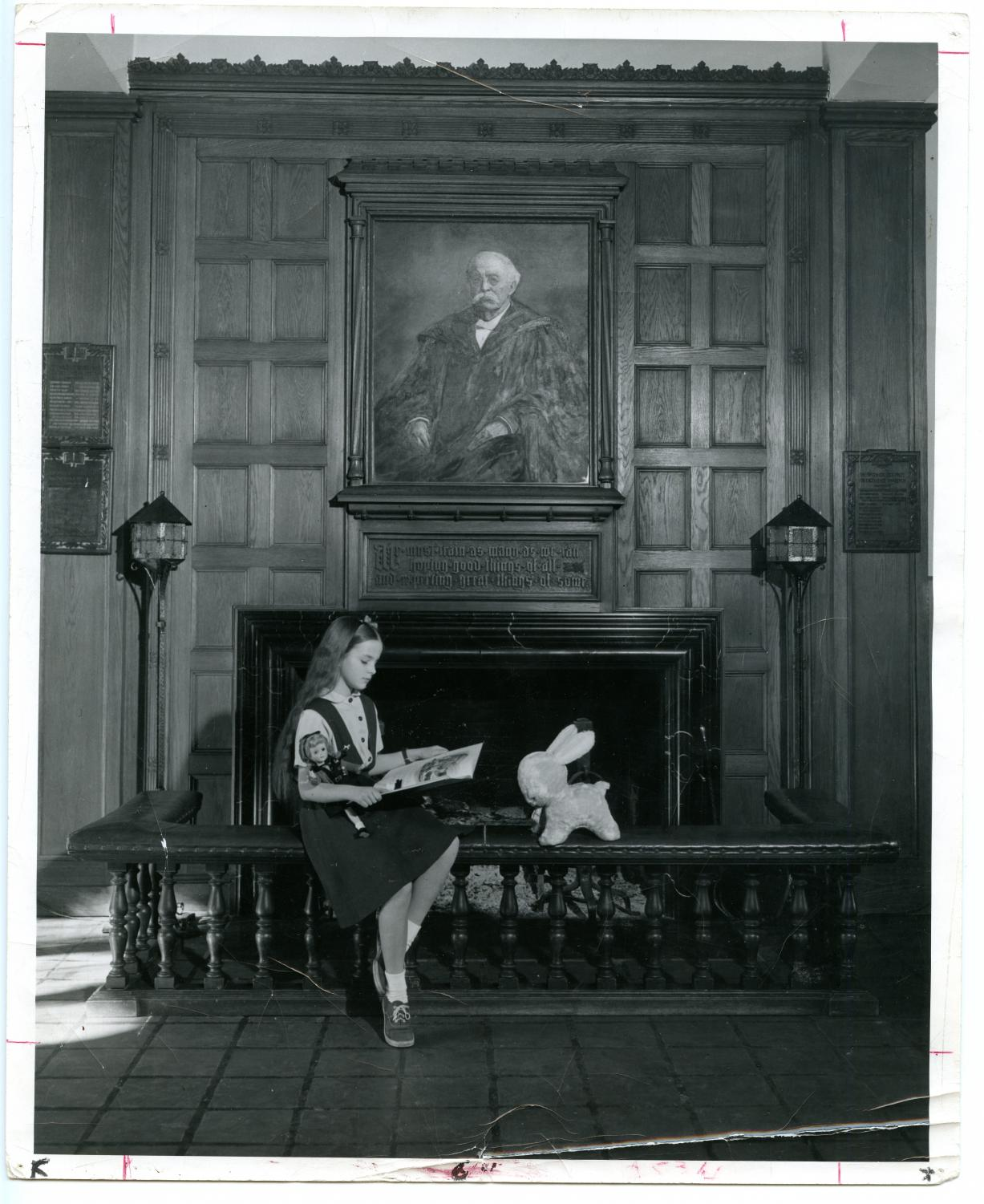 A student studies in front of the main fireplace of Northrop, circa 1951