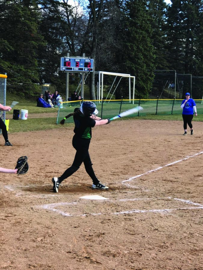 Kenna+Vavricheck+%2721+makes+good+contact+with+the+ball+as+she+swings.