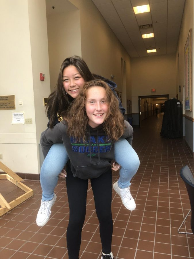 Becky Perkins '22 and Lilli Haselhorst '22 are ready for the Homecoming game in their Blake wear