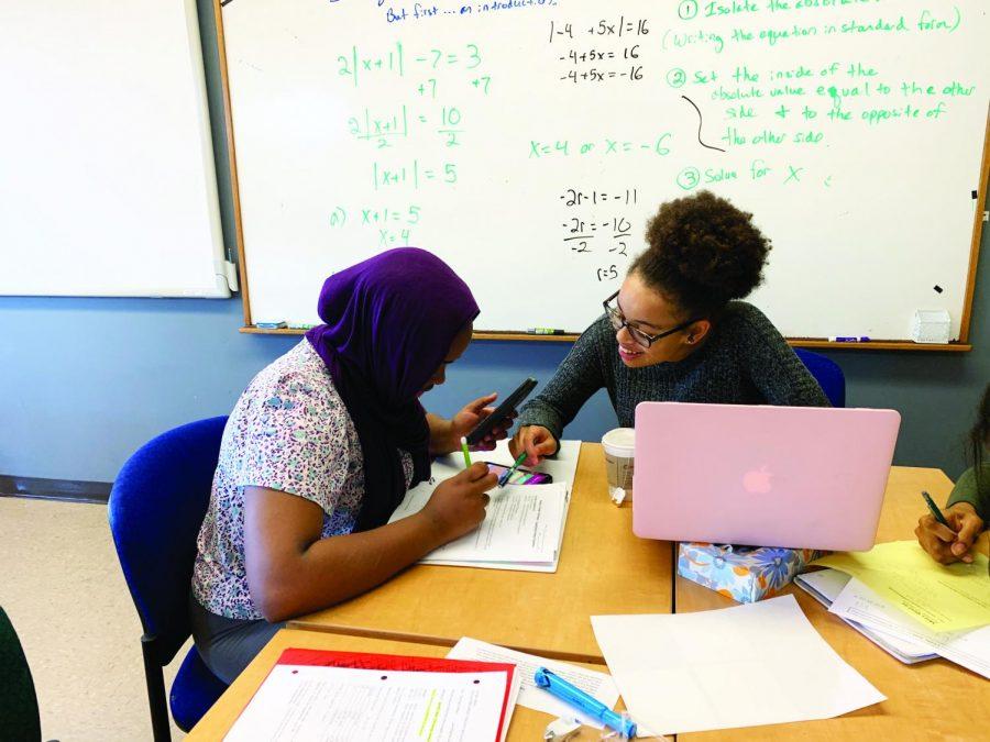 Habon Samatar '22 and Rabi Michael-Crushshon '22 collaborate on a math assignment.