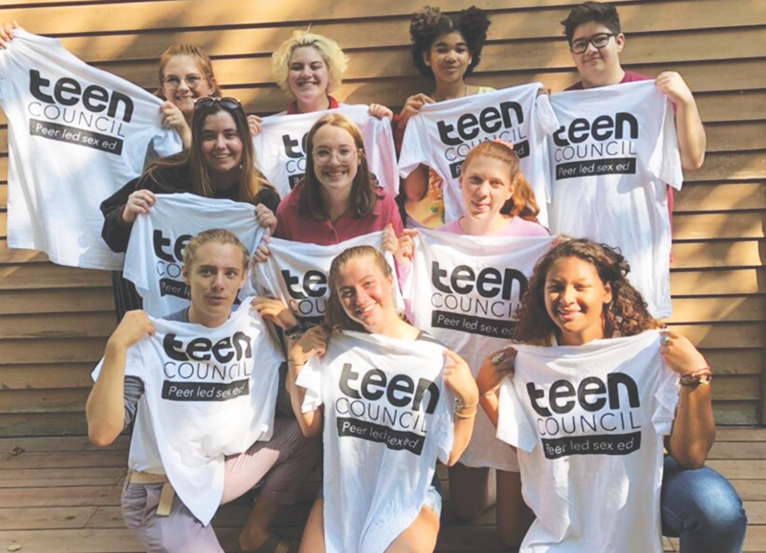 Annabelle Swigert '22, center front, and Planned Parenthood Teen Council sport their new shirts.