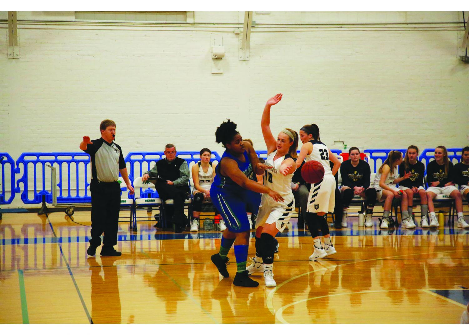 Cheryl Minde '20, the only senior on the team this year, reaches around a defender to pass the ball to her teammate.