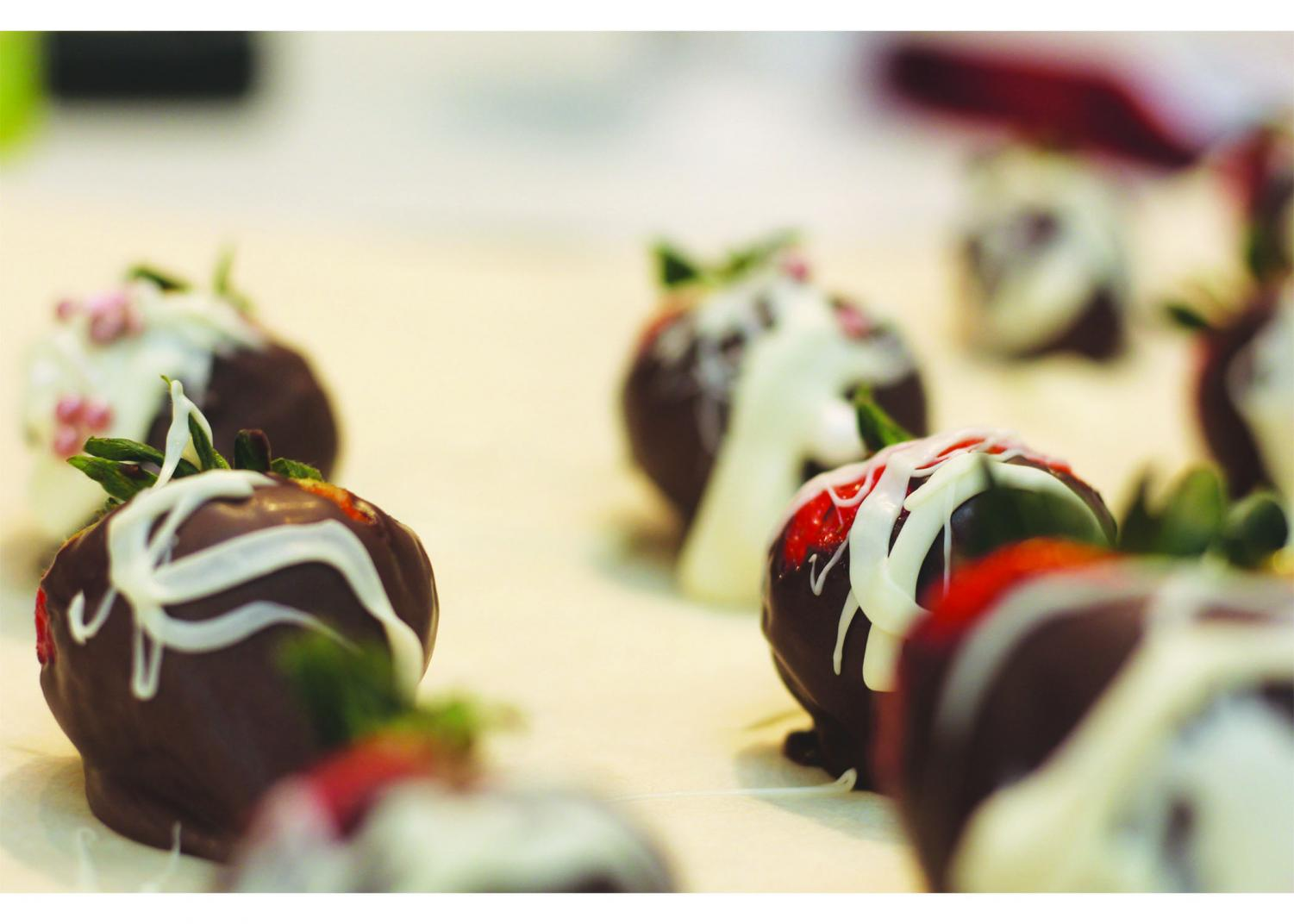 Maggie Seidel '22 creates these festive white chocolate drizzled and chocolate covered strawberries from the original recipe by Driscoll's berries.