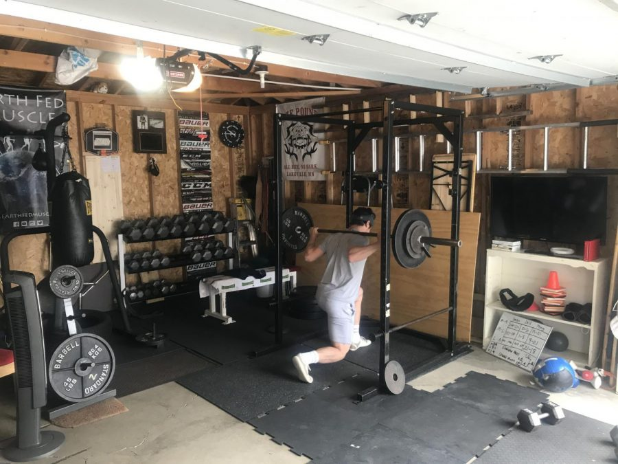 Lachen Reid '20 works out in his home gym.