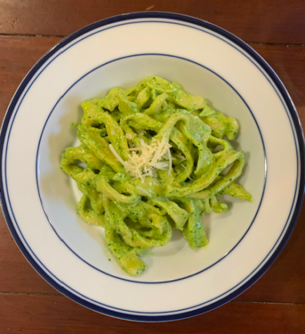 The finished cut and cooked pasta mixed with pesto.