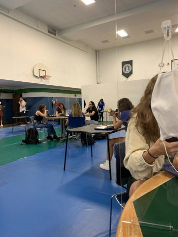 Tables of four students now separate each person by a plexiglass structure. This ensures that students are safe when eating, as their masks are off during this period of time. Students are required to wear their masks at all other times of the day. There are also individual desks in the lunch room, also six feet apart from any other table or desk.