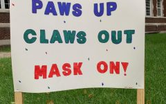 SIAC makes fun posters to remind students to stay safe and keep their masks on.