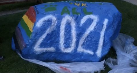 Seniors paint the rock outside the West Entrance.