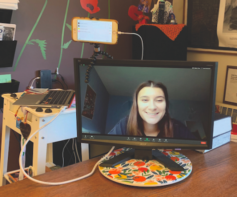 Anna Reid's set up in her classroom consists of three devices: her computer, her phone, and a monitor that all display different parts of the Zoom.