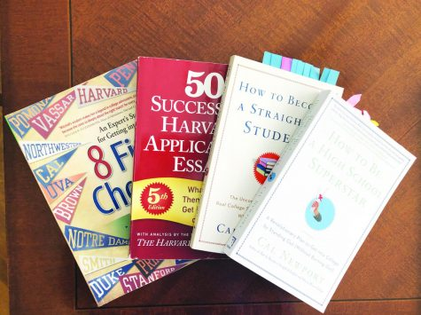 Students may turn to books and other resources to perfect their college essays.
