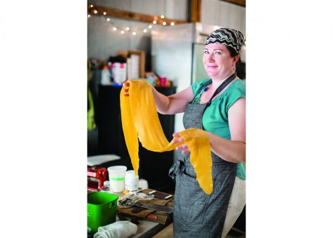 Thomas makes homemade pasta at Threshing Table Farm, a farm in Wisconsin. She partners with them for farm fresh produce and also has farm dinners outside.